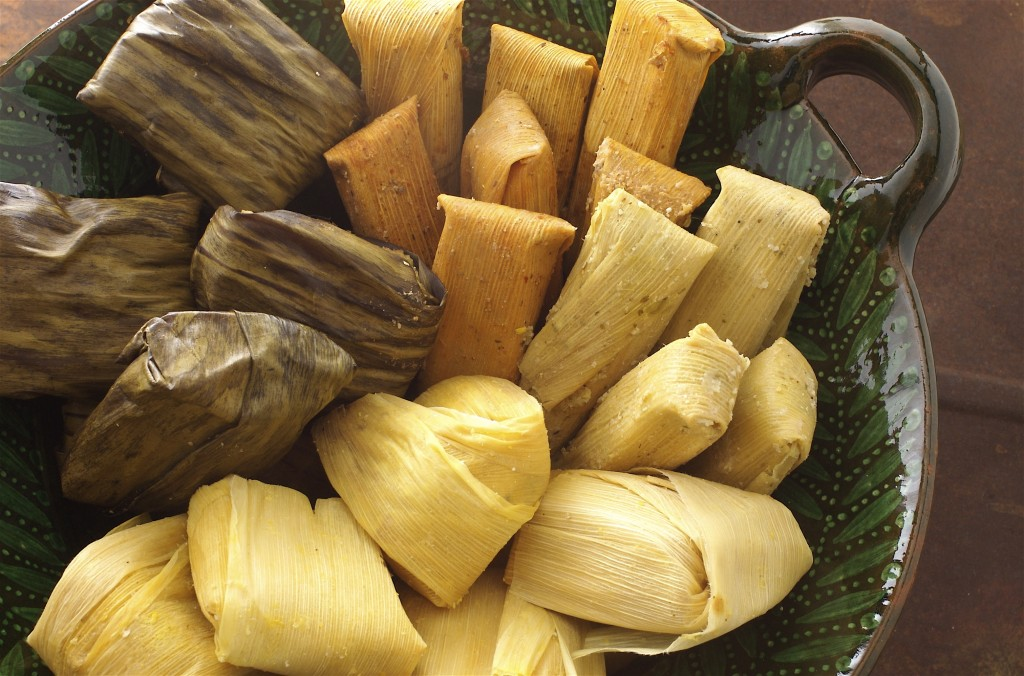 Tamales: corn dough filled with meat of vegetables, boiled inside corn husks