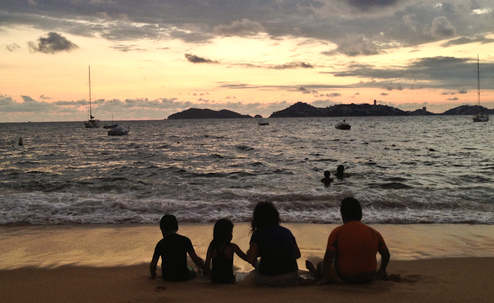 Sunset over Acapulco with kids