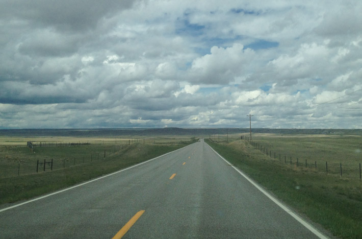 The open road in Montana, under a storm.