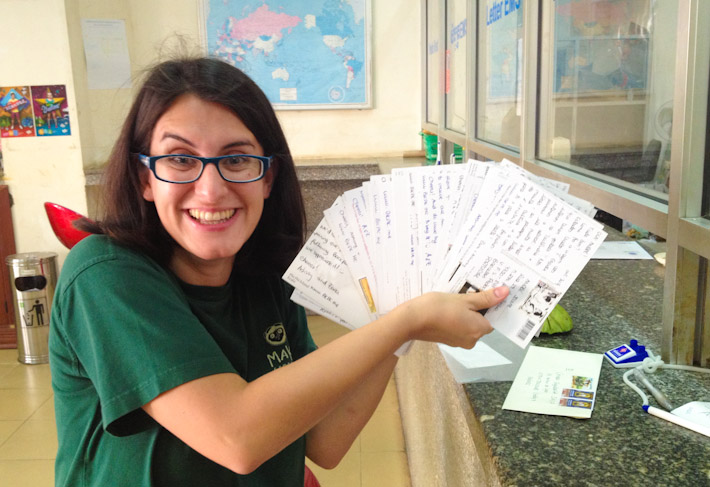 Z looking like a crazy scientist sending a ton of cards from Phnom Penh, Cambodia