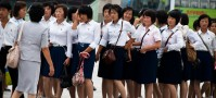 North Korean high school students in rows of two on their way to the library