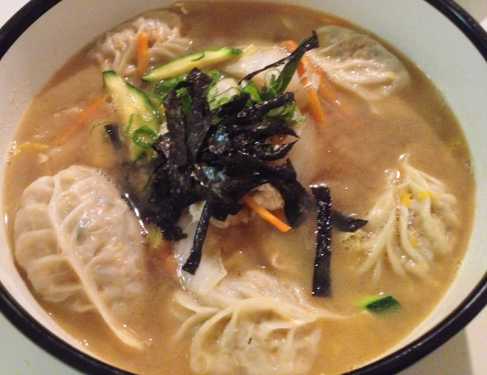 Mandoo Soup: Korean vegetable dumplings in broth, topped with seaweed