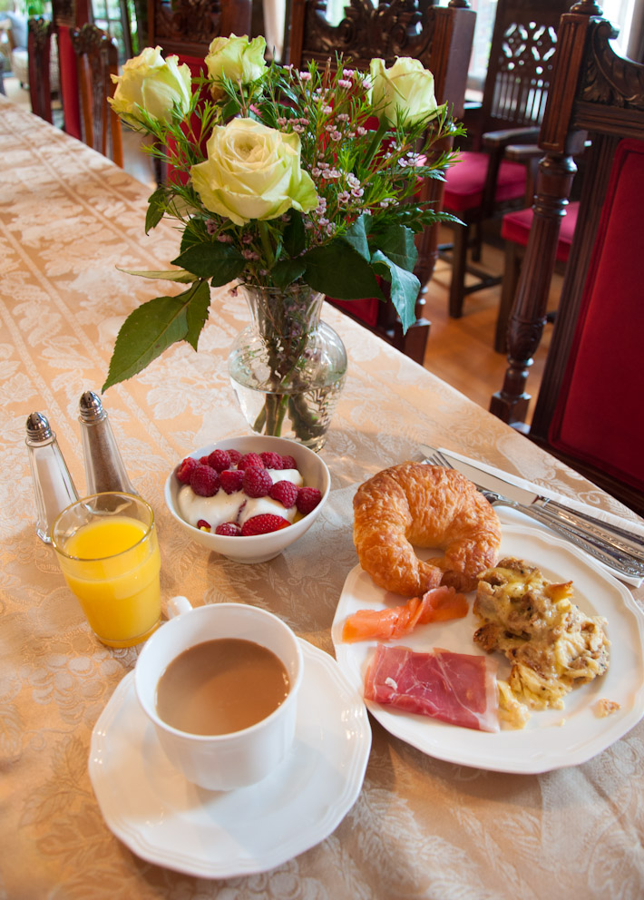 A B&B breakfast as it should be: raspberries in yogurt, egg au gratin, prosciutto, smoked salmon, croissant, fresh orange juice and coffee latte. With love, in Seattle.