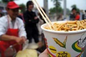 Getting a bowl of noodles from the street vendor in Beijing