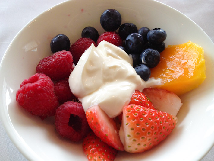 Raspberries, blueberries, strawberries and mango with lusciously thick yogurt