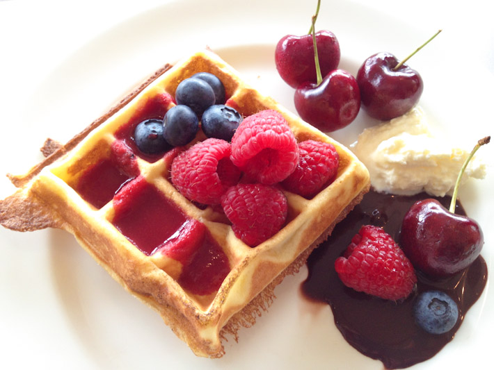Waffle with berries, cherries, dark chocolate and whipped cream - and the first meal of the day is officially over!