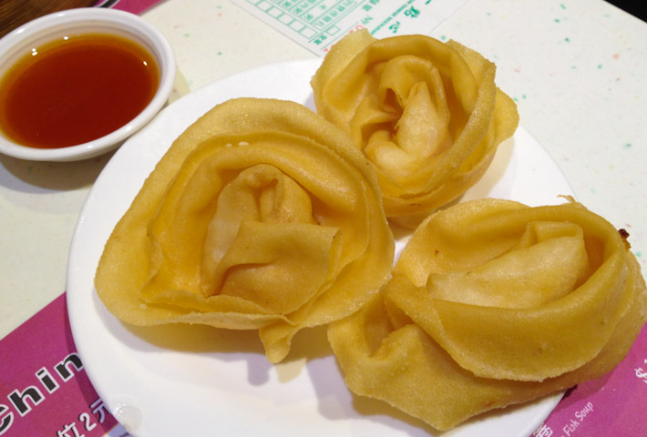 "Deep fried dumplings with sweet & sour sauce. The waiter called them ""Chinese Ravioli"" :D"