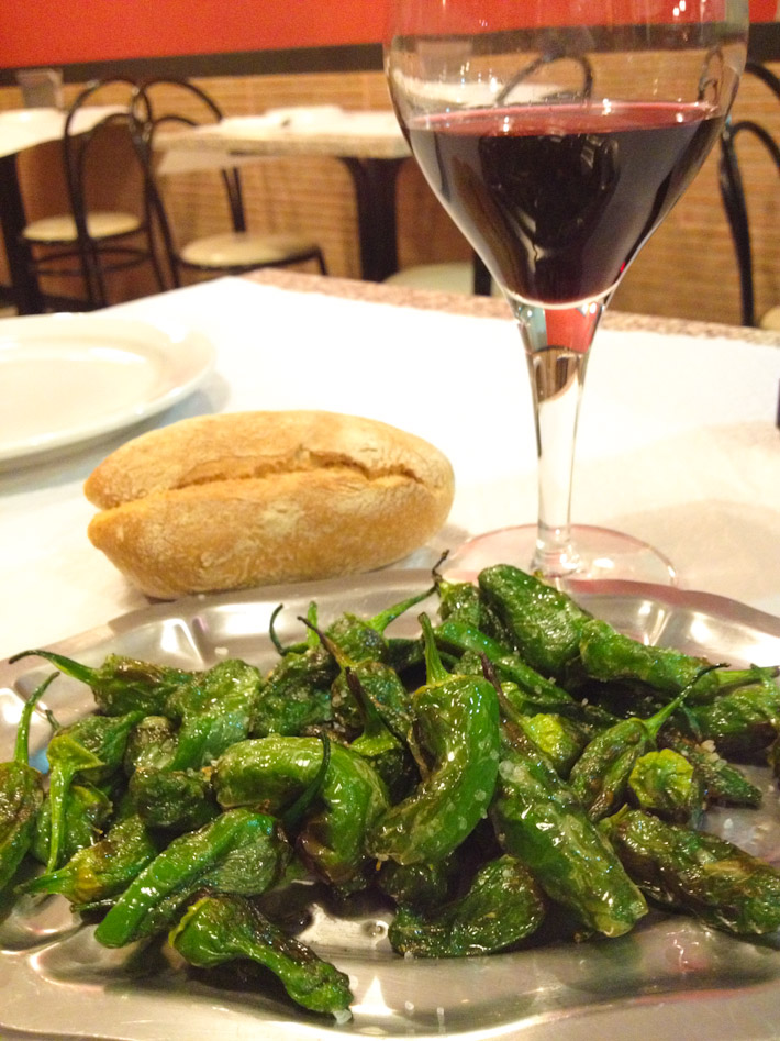 Pimientos de Padron: slightly fried and salted. Best with country-side style bread and red wine from Galicia!