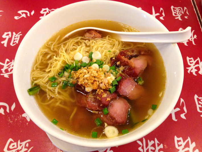 BBQ pork and egg noodle soup, topped with plenty of spring onions
