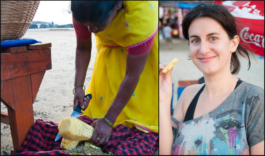 Enjoying freshly cut pineapple from a beach vendor in Vagator Beach, Goa