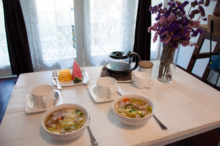 Thai Breakfast: rice congee with pork meatballs and veggies, seasonal fruits and coffee
