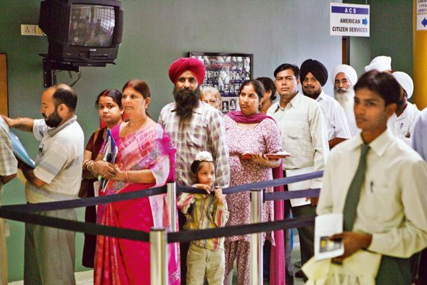 People waiting for visa at the consular section of the US embassy, in New Delhi. Photo: AP