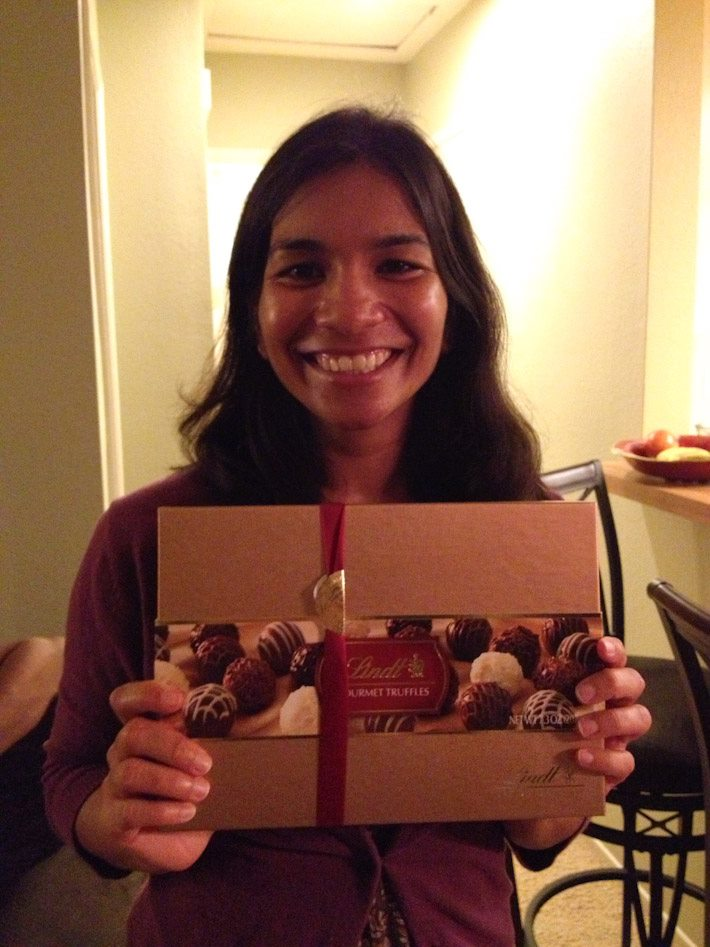 Sakshi enjoying some chocolate truffles we brought as thank-you gift