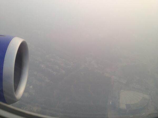 About to land in smog covered New Delhi (Dec. 2013)