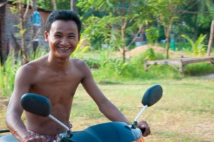 Smiling Man on bike in Cambodia