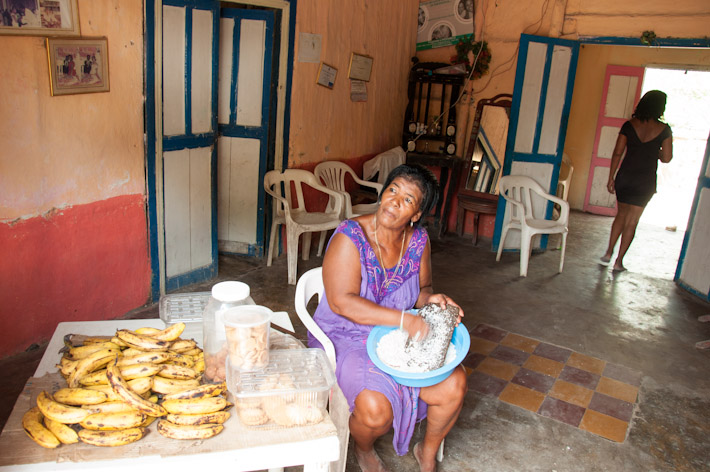 Lady making cocadas (local coconut sweets) from scratch - fresh and delicious!
