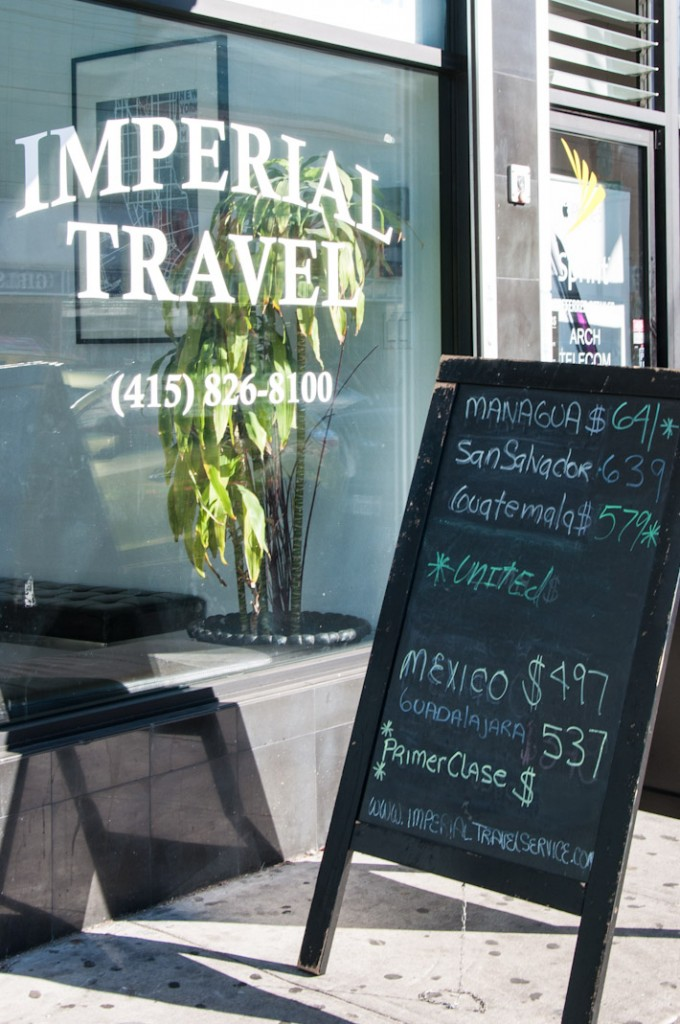 Travel agents display promos for trips to destinations all over Latin America