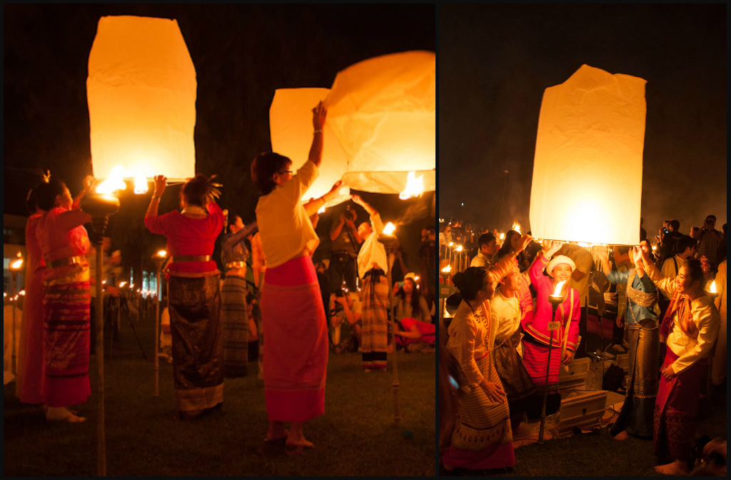 A group of friends with traditional Lanna clothes prepare to release their lanterns into the sky