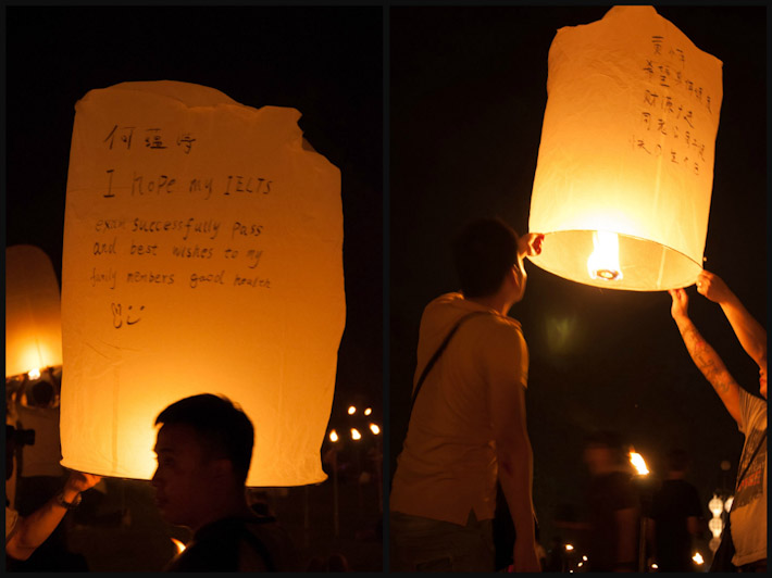 People write their messages and wishes on their lanterns