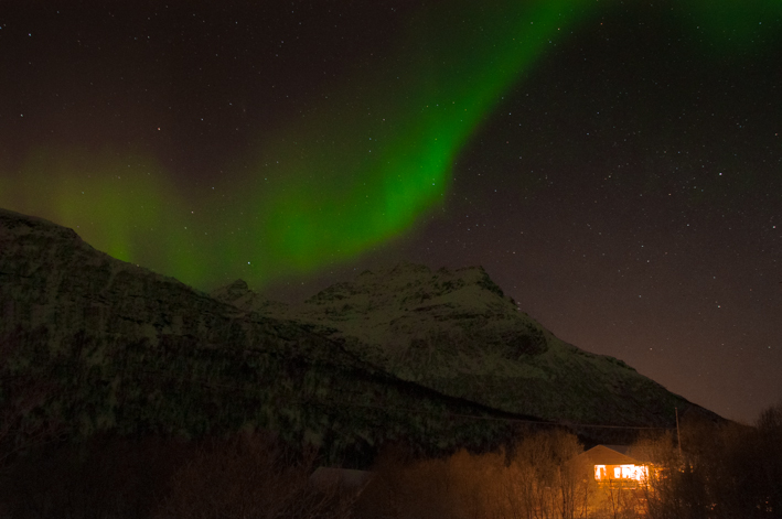 Northern Lights over a Cozy Cottage
