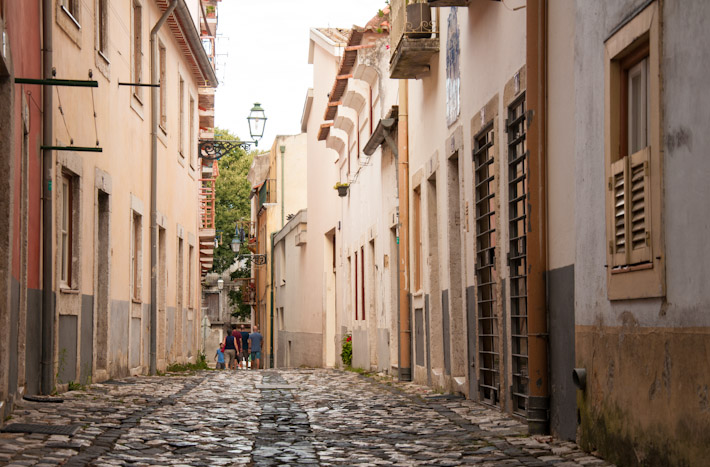 The streets of traditional areas of Lisbon are covered in cobblestone
