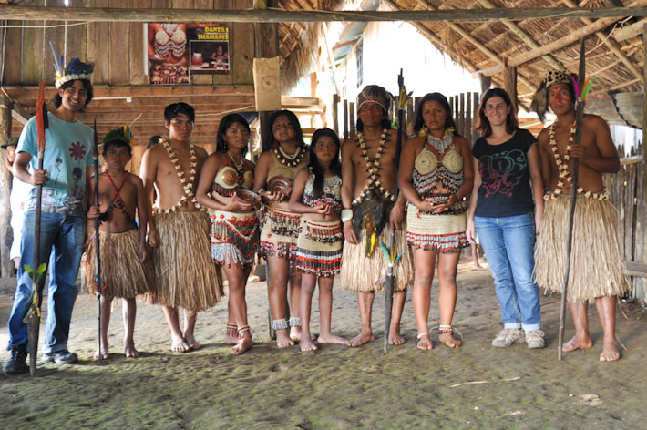 Posing with a local group of dancers in the Amazon Jungle, Ecuador. A rather touristic experience but we got to see where they live, what they eat, etc..