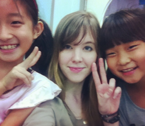 Marie taking a selfie during class with her students in South Korea
