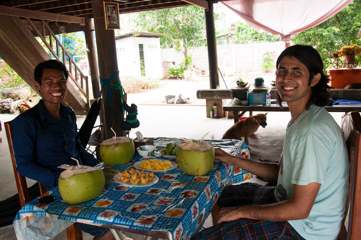 Eating with a local student in Cambodia - 'cause fresh coconut tastes better with great company and tales of local life!