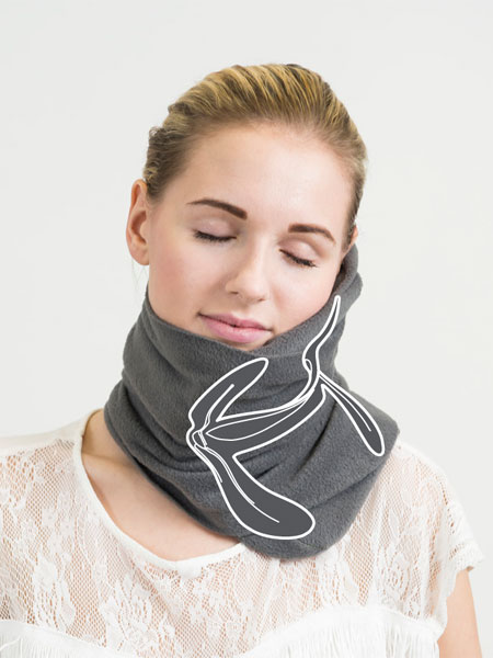 The NapScarft holds your neck in a better position than a standard U-shaped travel pillow