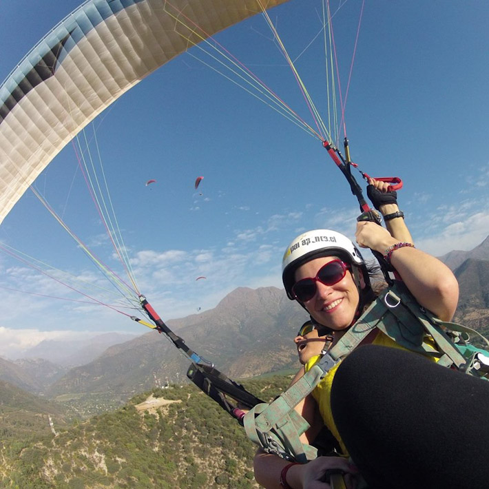 Nomadic Chica paragliding in Chile