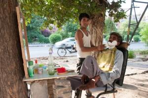 Street barbershop in India