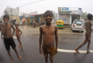 Kids playing in the rain in Delhi