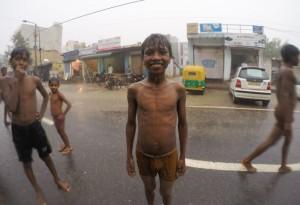 Kids playing in the rain in Delhi