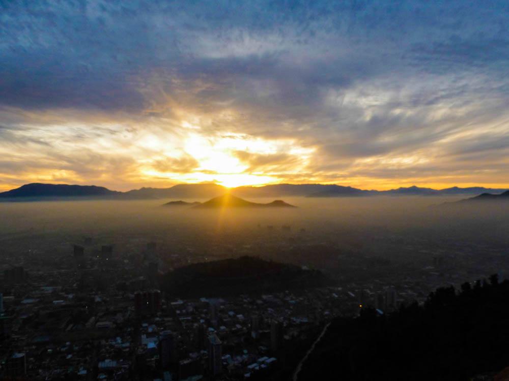 The winter sun setting over Santiago