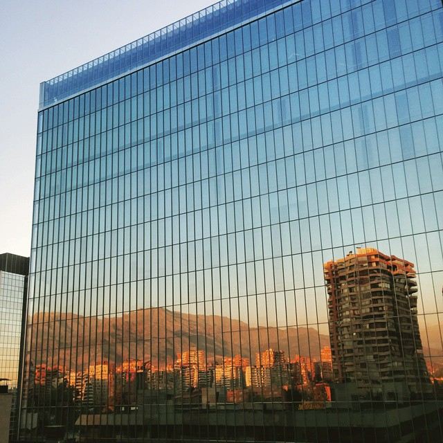 The Andes mountains reflected on a glass building in Santiago de Chile