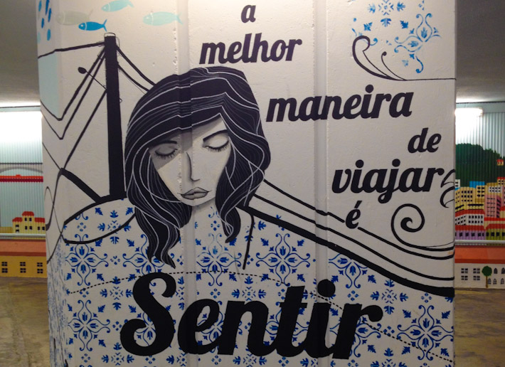 """The best way to travel is to feel"", mural in Lisbon"
