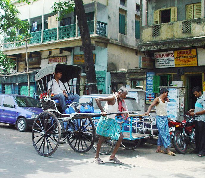 Man-pulled rickshaw in Calcutta. Photo from Wikipedia