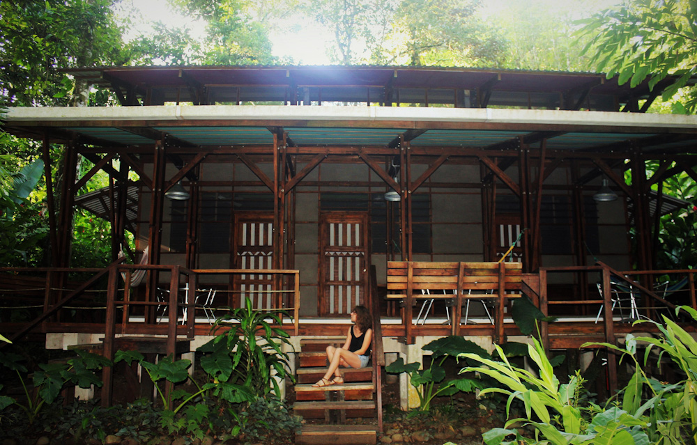 Charlie sitting at La Kukula Lodge cabin eco design