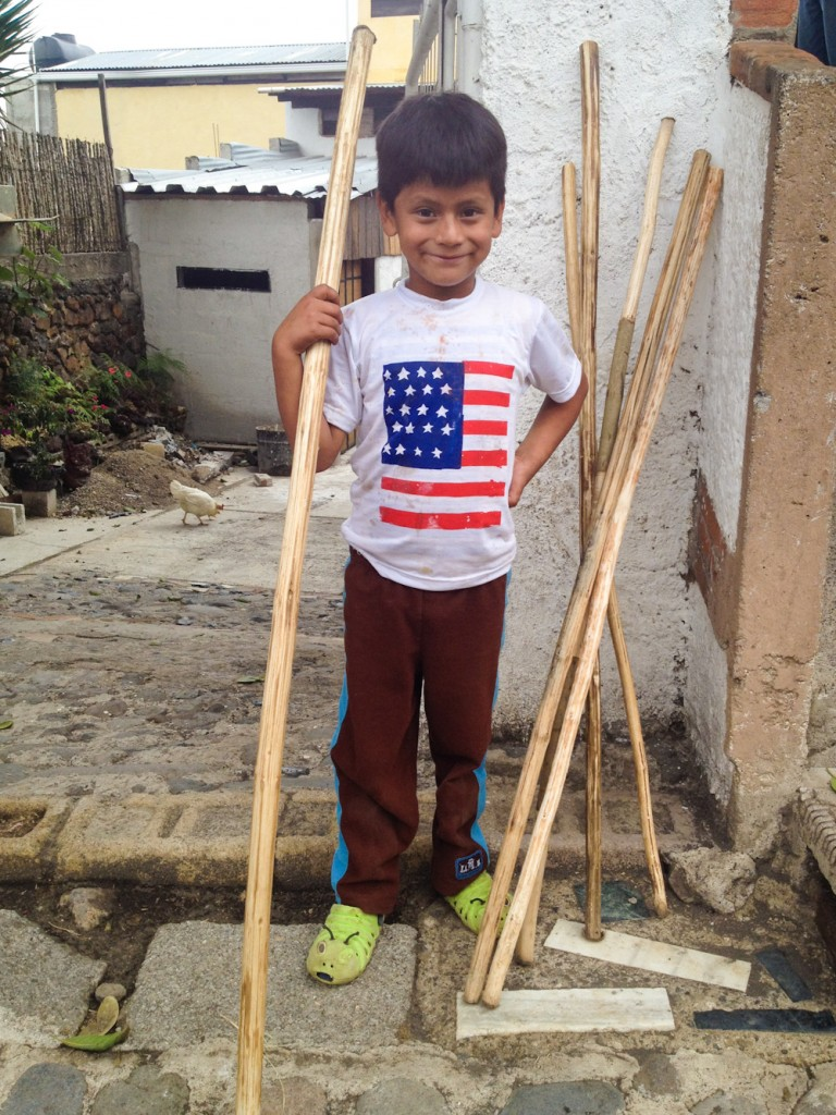 Kids sell walking sticks for 5 Quetzales to Pacaya visitors