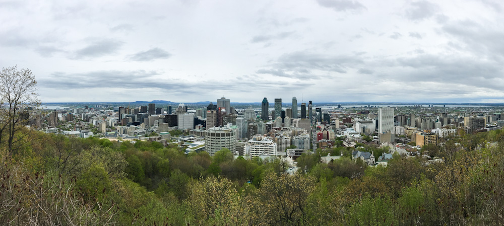 The skyline of Montreal as seen from the top of Mount Royal on a cloudy day