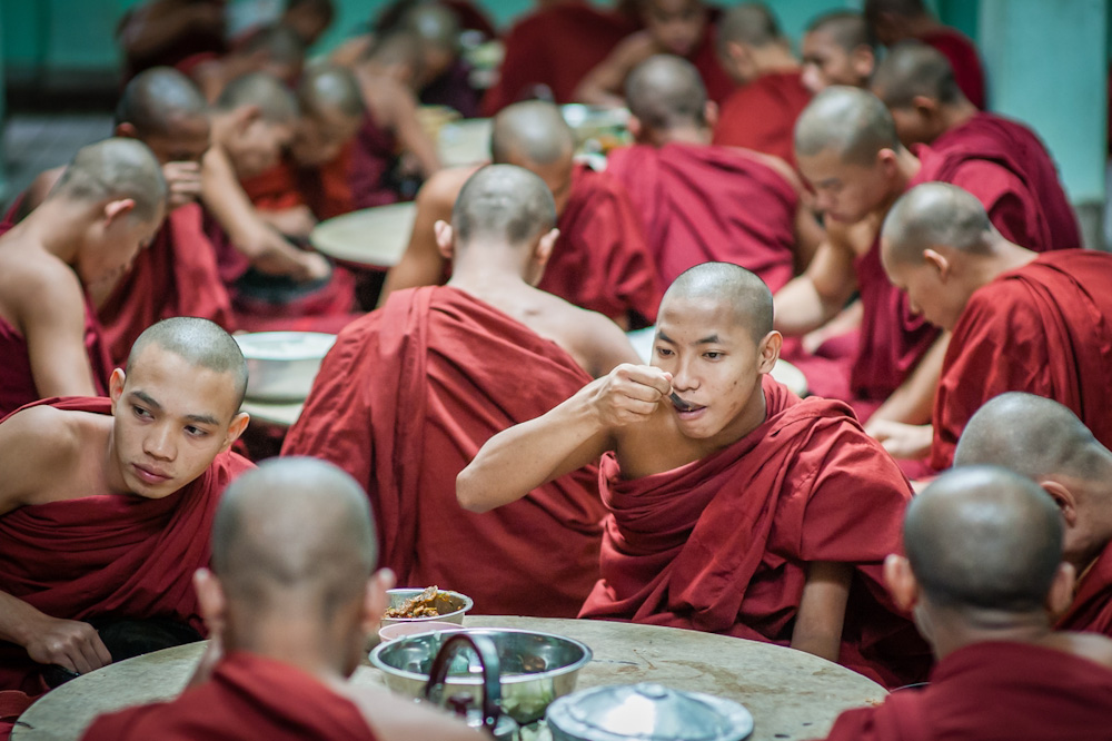 Buddhist monks' lunch ceremony at Kha Khat Wain Kyaung monastery in Bago