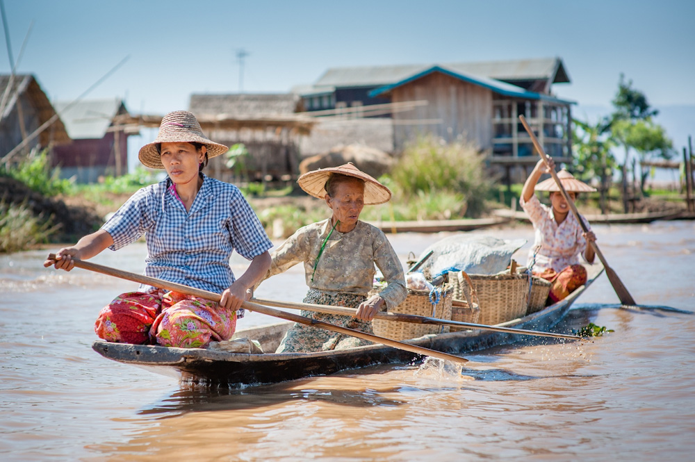 Women paddling on boat on the Inle Lake