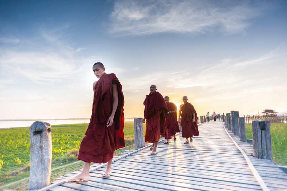 Buddhist monks sunset walk on U Bein bridge