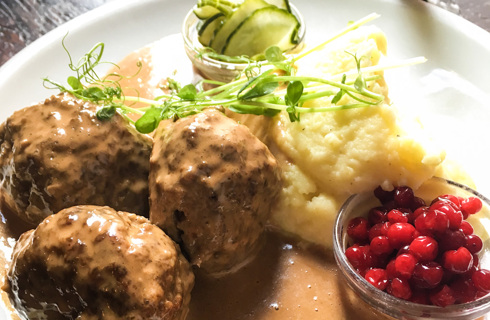 Quite probably, the most typical Swedish meal: meatballs with mashed potatoes, lingonberries and pickled cucumbers