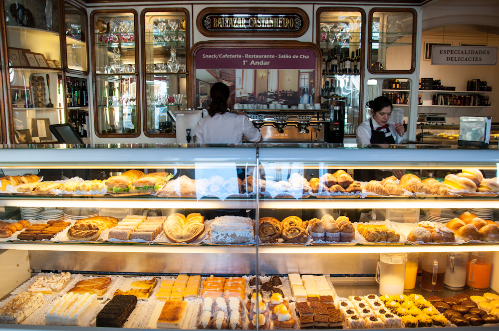 Typical pastries counter at a pastelaria in Lisbon