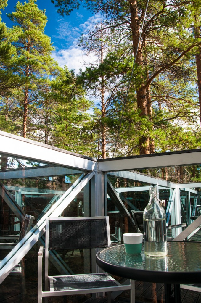 The rooftop balcony of The Mirror Cube: with views of the surrounding forest, the Lule River in the distance and yourself right there, in the mirrors!