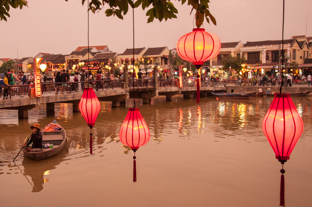 Chinese style lamps hanging in the trees by the river in Hoi An's Old Town