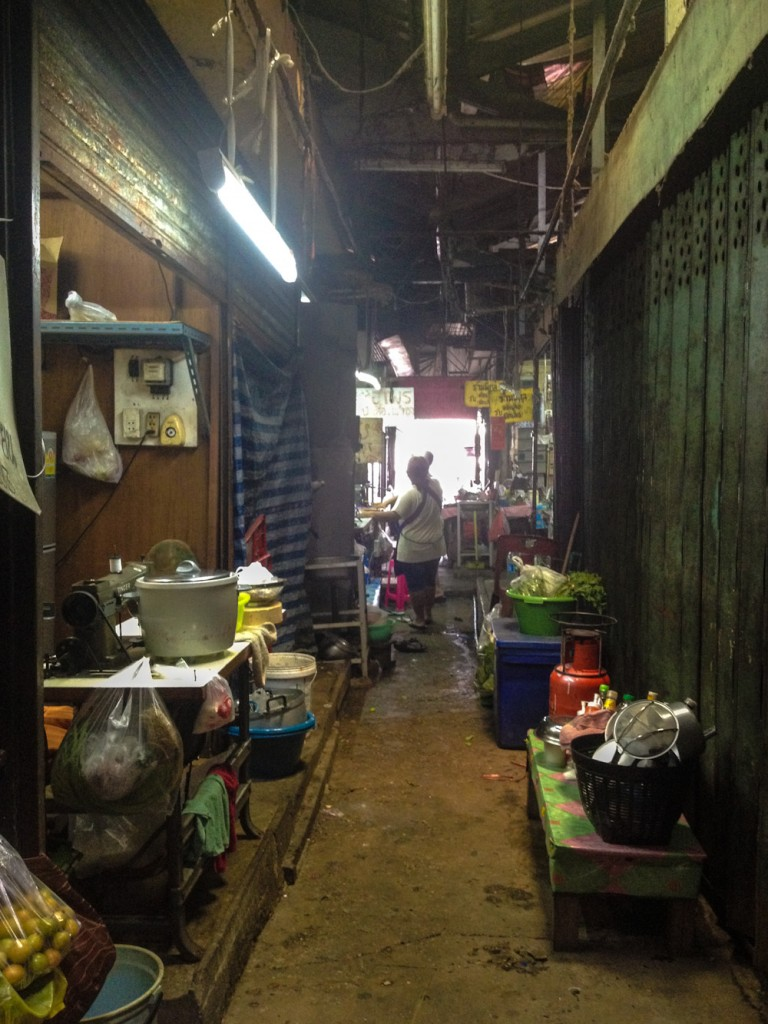 The vending stalls at Khlong Toei Market are connected by narrow lanes such as this one