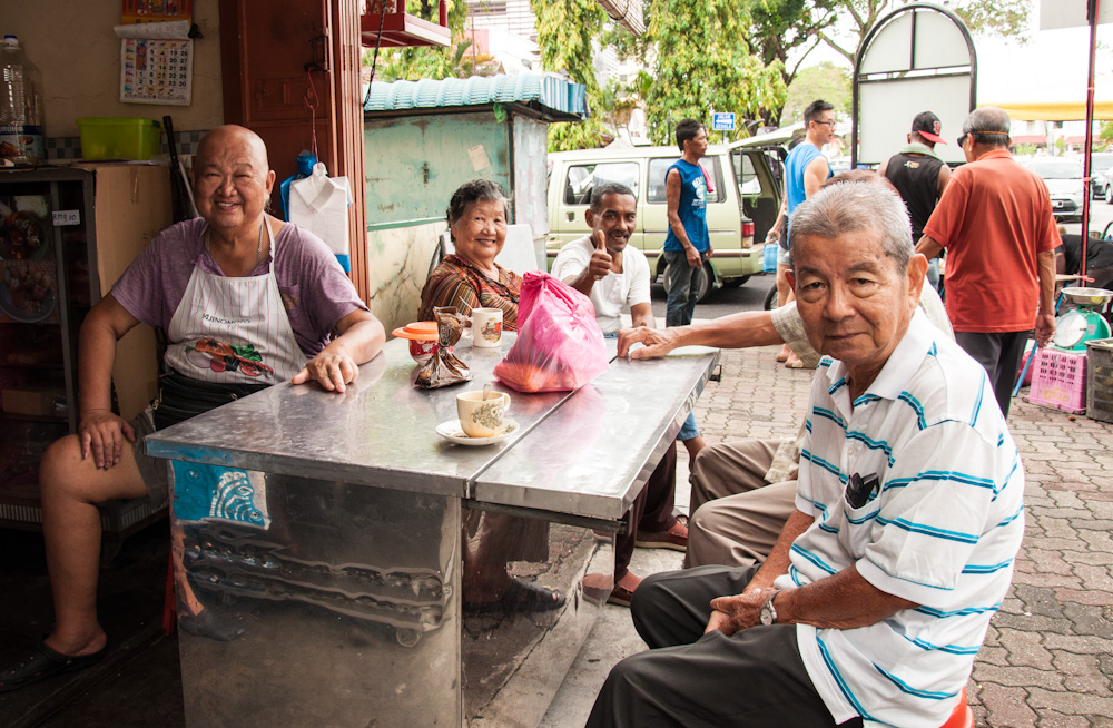 Locals hanging out by the local market in Penang