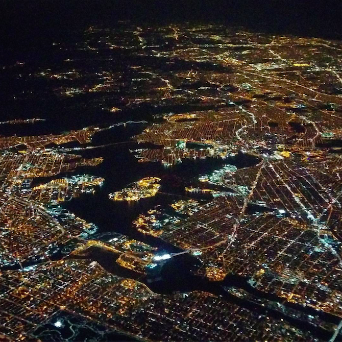 Shinning city lights, as our plane descends over New York